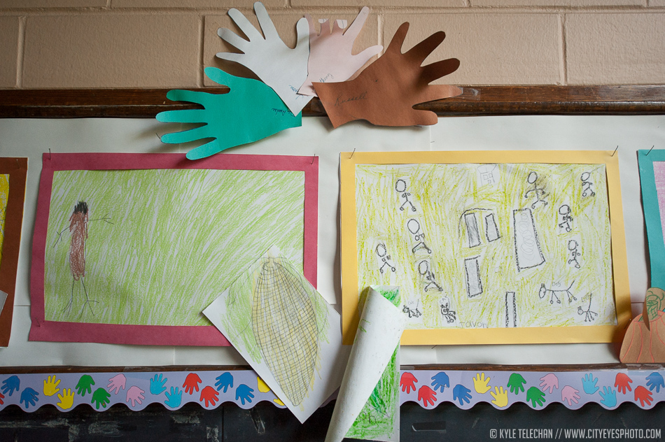 It's upsetting that the kids who made these drawings and handprints are being displaced - likely crammed into an unfamiliar, overcrowded, underfunded classroom.