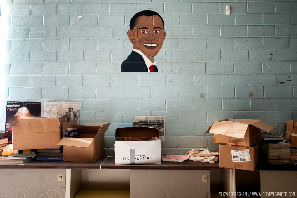A painting of the current president overlooks the abandoned classroom.