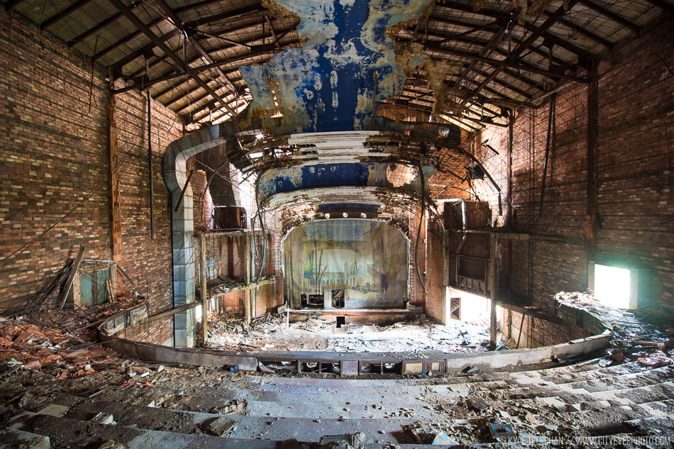 Overview of the abandoned theater - backdrop intact.