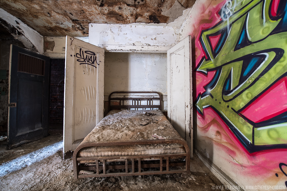 A Murphy bed folds out of the wall in an apartment at the abandoned theater.